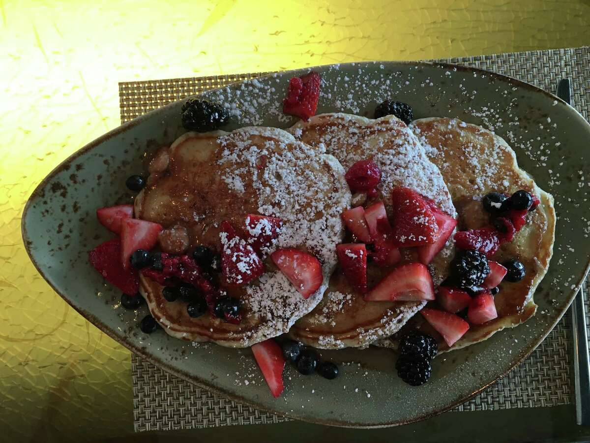 Pancakes topped with fruit at Triniti