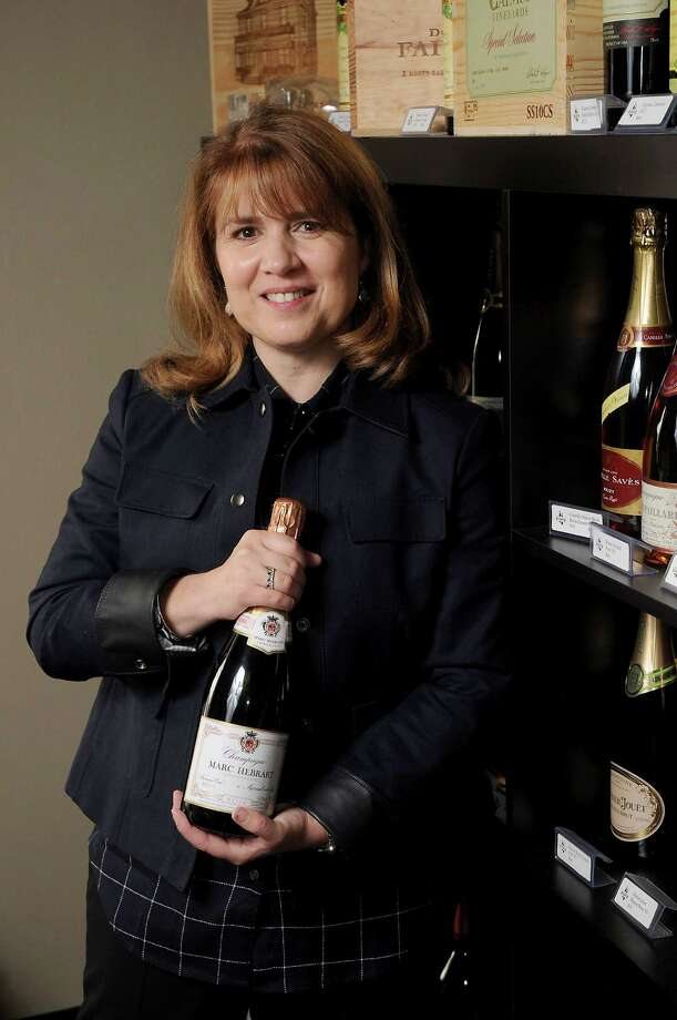 Kelly Prohl with a bottle of Marc Hebrart Rose Champagne Wednesday March 16,2016.(Dave Rossman Photo) Photo: Dave Rossman, Freelance / Dave Rossman