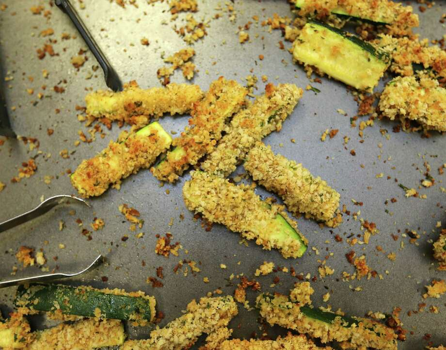 Panko-crusted zucchini fries were one of the items at cooking class at Jackson Intermediate School hosted by the Houston Food Bank and featuring Houston Texan Jon Weeks and his wife, Amanda, on Wednesday, March 9, 2016, in Pasedena. ( Elizabeth Conley / Houston Chronicle ) Photo: Elizabeth Conley, Staff / © 2016 Houston Chronicle
