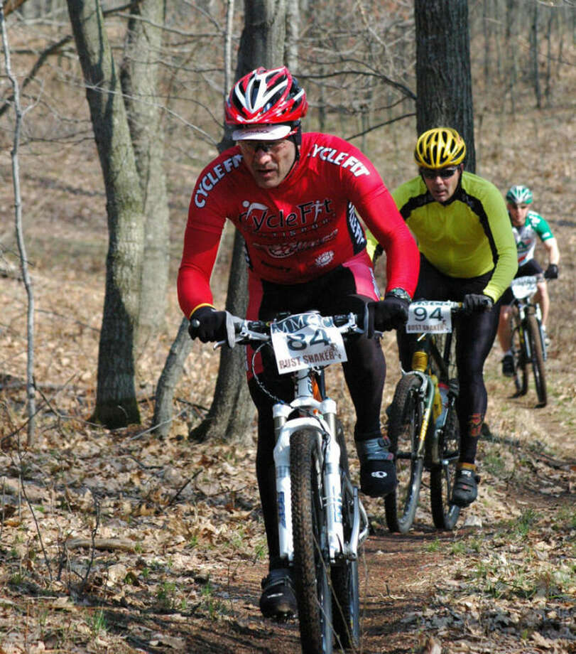 Participants in the race ride on the Mid Michigan Community College campus bike trail in this file photo.
