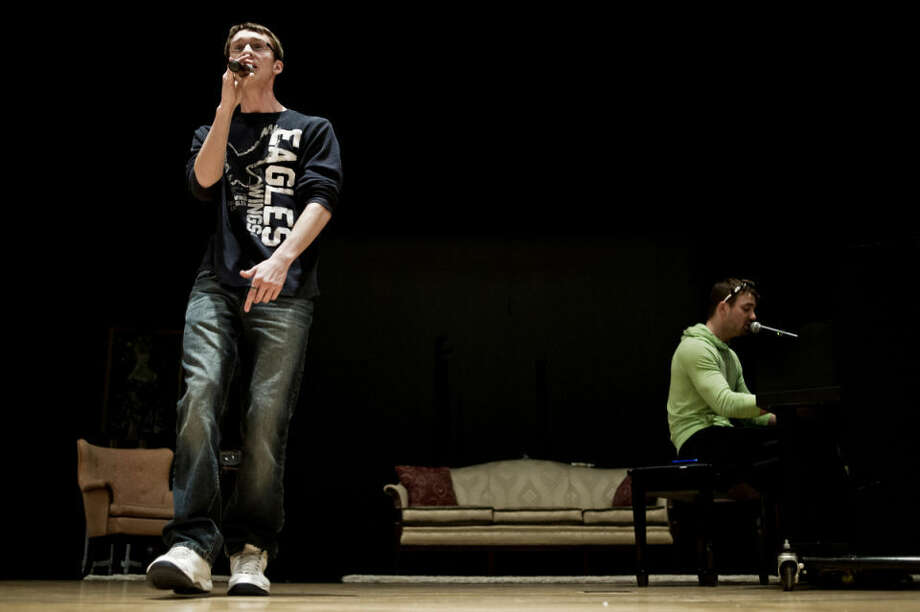 """Isaiah Marr, left, of Essexville, and Jon Bailey, of Midland, practice a song together Thursday evening during a rehearsal for """"Laugh for a Change"""" at the Bullock Creek High School Auditorium. Marr and Bailey are both winners of Recovery Idol and will be preforming at the Ten16 Laugh for a Change Fundraiser on April 26, along with fellow winner Howard Thomas Jr., of Midland, and comedian Mark Lundholm. Photo: Sean Proctor/Midland Daily News"""