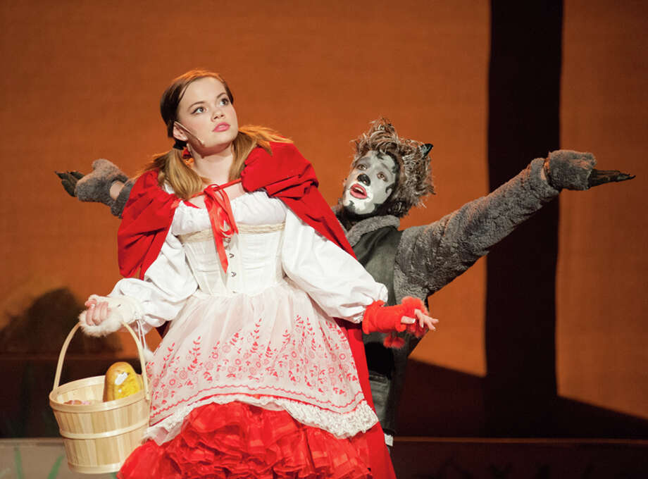 "STEVEN SIMPKINS | Daily NewsLittle Red Riding Hood, Sophia Bagnall, and Wolf, Josiah Greiner, perform in the Midland High School drama ""Into the Woods."""