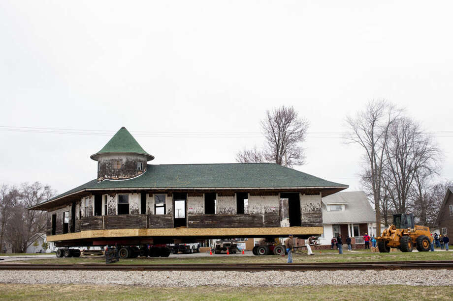 The Clare Railroad Depot is moved 900 feet from its original location off 5th Street to its new downtown Clare location. Photo: ZACK WITTMAN | For The Daily News