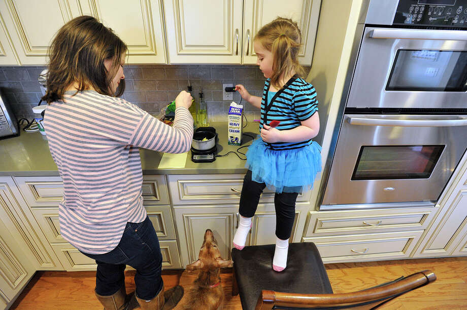Taken a year ago, Dana Haddox-Wright of Wilton and her five-year-old daughter Ella Wright, who has Dravet syndrome, a form of childhood epilepsy, plan a meal together. Under legislation that was approved by a legislative committee on Monday, Haddox-Wright would be allowed to give Ella, now six, a form of liquid marijuana extract found to help seizures. Photo: Jason Rearick / Jason Rearick / Stamford Advocate