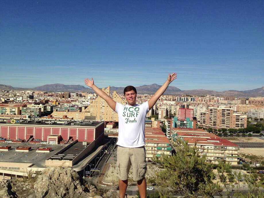 Brandon Dull stands with the city of Alicante, Spain, in the background. Photo: Photo Provided