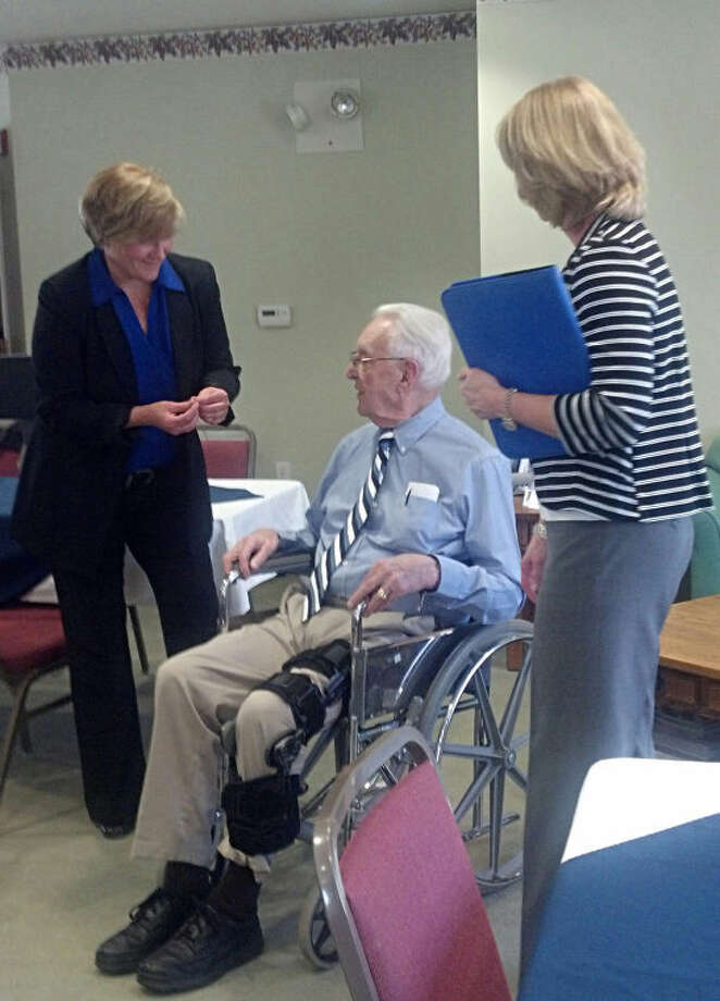 Jack Telfer | jtelferii@mdn.netPapa Joe Lubbehusen receives a pin and recognition from the Alzheimer's Association for being a top 50 fundraiser for the organization.