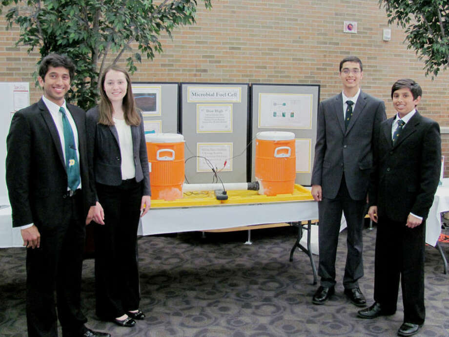 "JOHN KENNETT | jkennett@mdn.netThe Dow High team members are, from left, Vikram Shanker, Catherine Haslam, Blair Subbaraman and Varun Shanker. Not pictured is Austen Zhu. The ""Microbial Fuel Cell"" team took first place at Saturday's inaugural A. H. Nickless Innovation Competition."