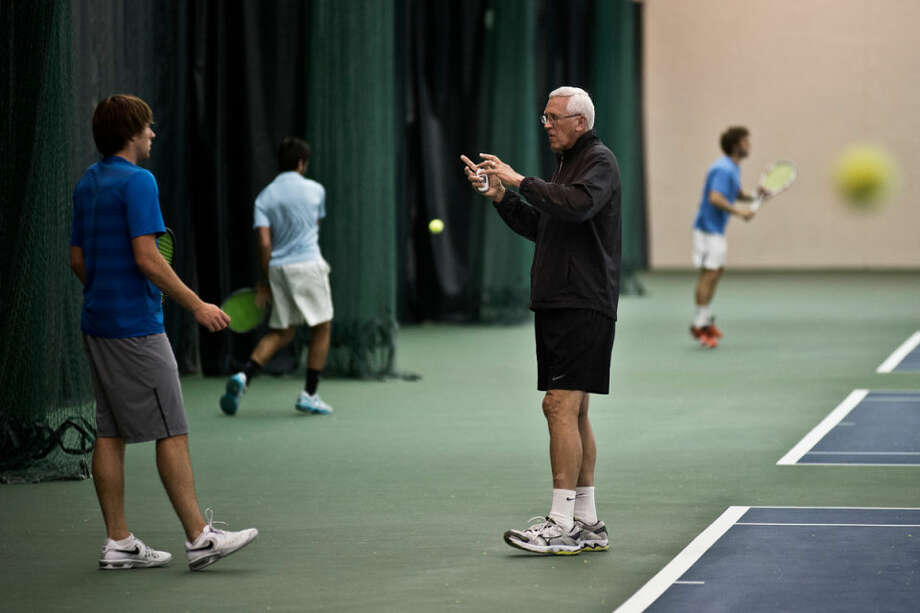 SEAN PROCTOR | sproctor@mdn.netZane Colestock, the tennis coach at Northwood University, talks to freshman Austin Woody during practice on Wednesday at the Midland Community Tennis Center. Colestock is in his 40th year of coaching at the school and is leading them to its 20th straight GLIAC title. Photo: Sean Proctor/Midland Daily News