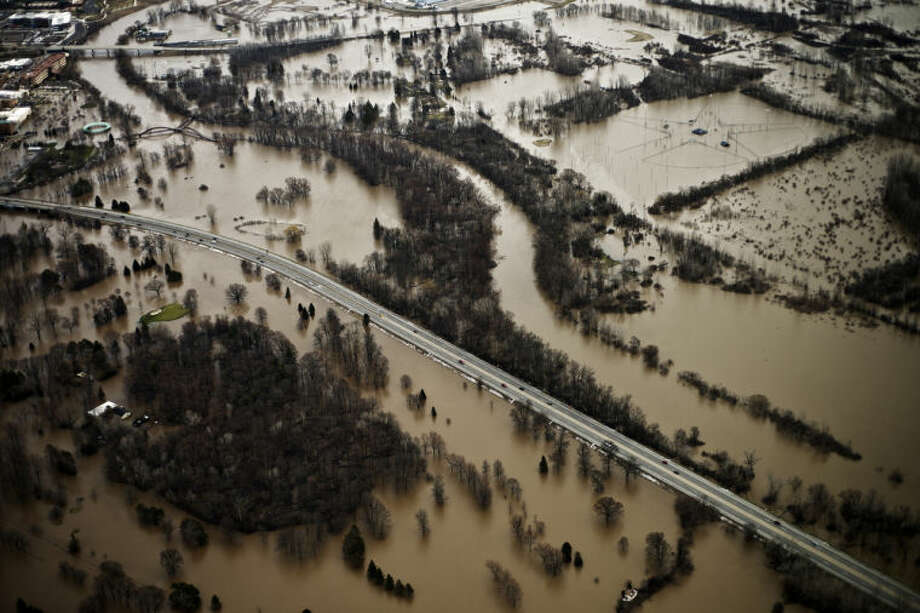 An aerial view of the Tittabawassee River flooding shows Currie Golf Course, M-20 and parts of downtown Midland. Photo: Sean Proctor/Midland Daily News
