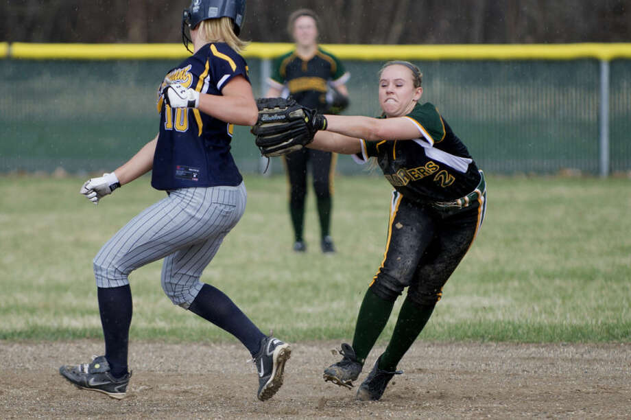 NEIL BLAKE | nblake@mdn.netDow's Karina Moe tries to tag out Mount Pleasant's Maureen Conway during the first game of a doubleheader at H.H. Dow High School on Monday. Conway avoided the tag. Photo: Neil Blake/Midland Daily News