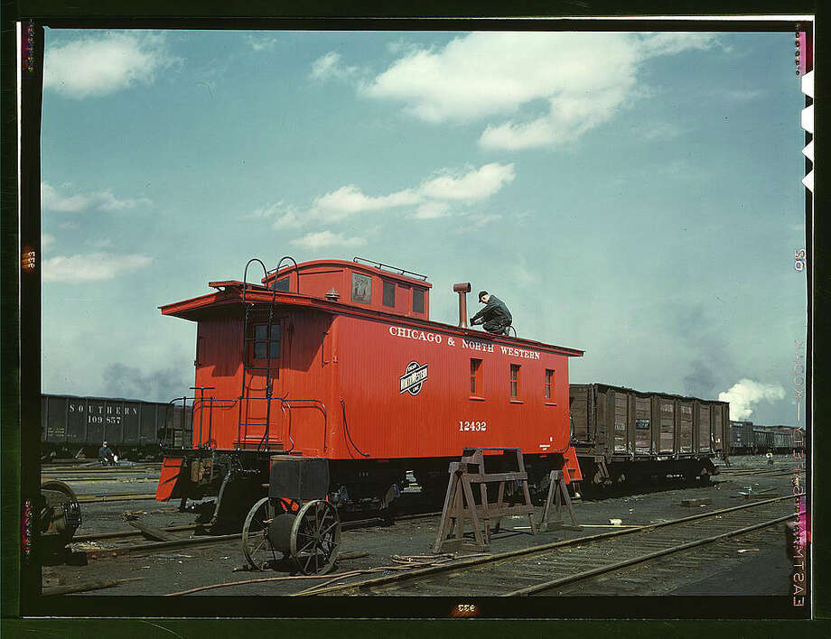 "Original caption reads: ""C & NW RR, putting the finishing touches on a rebuilt caboose at the rip tracks at Proviso yard, Chicago, Ill."" Photo dated April 1943, by Jack Delano. Photo: Farm Security Administration — Office Of War Information Collection, Library Of Congress / 2016 Public Domain"