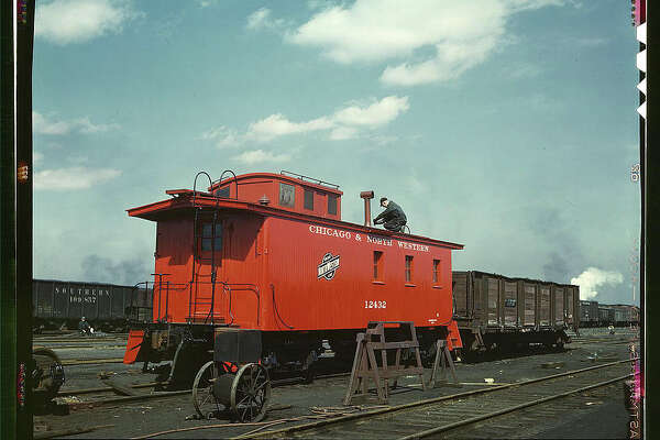 "Original caption reads: ""C & NW RR, putting the finishing touches on a rebuilt caboose at the rip tracks at Proviso yard, Chicago, Ill."" Photo dated April 1943, by Jack Delano."