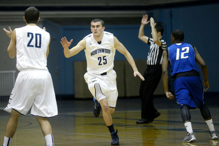 NICK KING | nking@mdn.netNorthwood's Dylan Langkabel, right, celebrates his 3-pointer with teammate Tony Johnson, left, during the first half of the Timberwolves' game against Grand Valley State Saturday at Northwood University. Photo: Nick King/Midland  Daily News