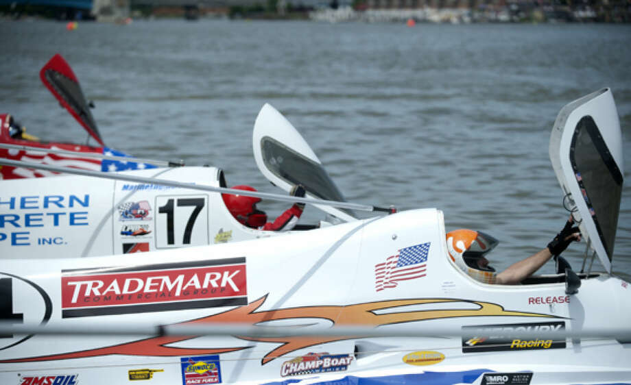 Formula 1 racers wait for the green flag to be lowered so they can start the race during the River Roar in Bay City on Saturday. Photo: Brittney Lohmiller