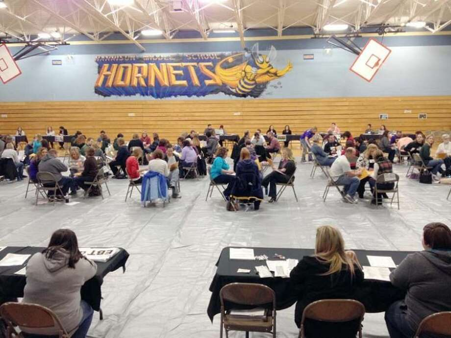 Local educators take part in a poverty simulation at Clare-Gladwin RESD Regional Professional Development Day.