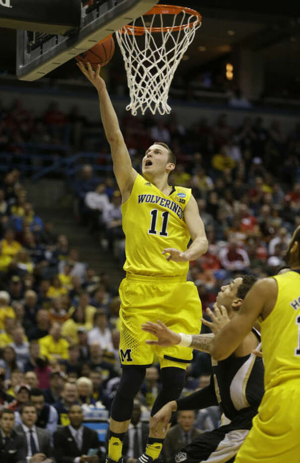 AP Photo | Jeffrey PhelpsMichigan guard Nik Stauskas (11) goes up for a basket during the second half of a NCAA tournament game against the Wofford Thursday. Photo: Jeffrey Phelps