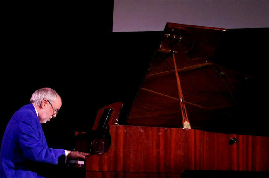 STUART FROHM | for the Daily NewsGrammy winner on Northwood stage Bob James of Traverse City — winner of two Grammys — performs one of his compositions during a free, public event in Northwood University's Griswold Lecture Hall Thursday evening. Photo: STUART M. FROHM