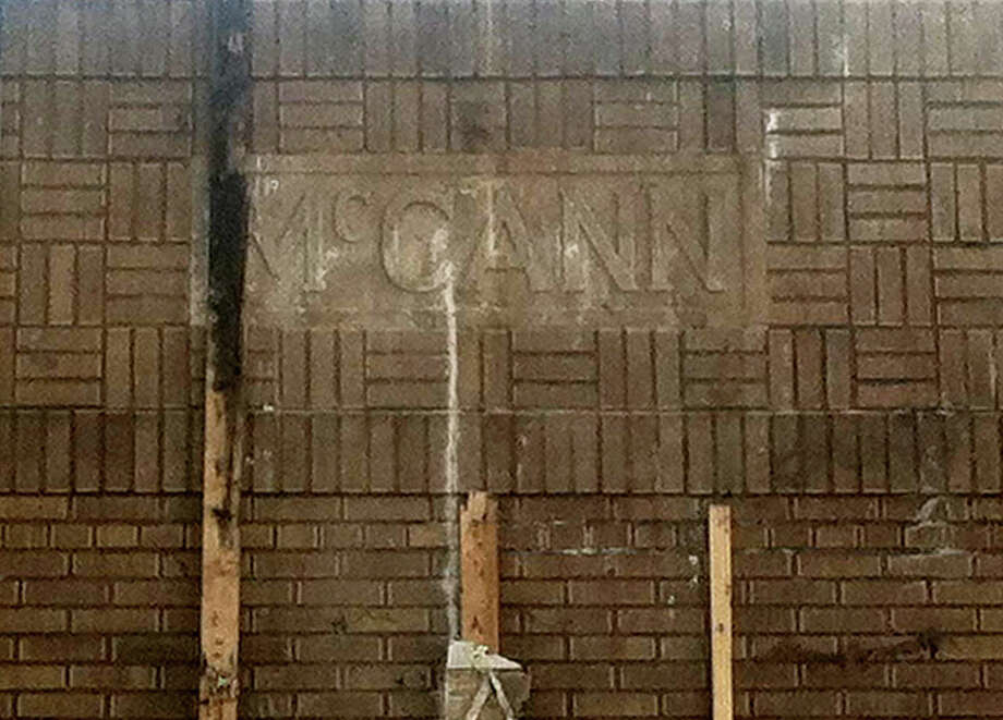 In this photo from the Downtown Midland, Michigan Facebook page, the McCann nameplate was revealed Tuesday during demolition.