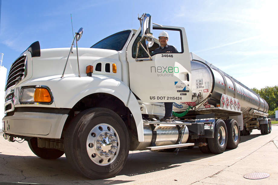 Nexeo Solutions, a reseller of chemicals, plastics and composites, ranks No. 4 on the Houston Chronicle 100 list of the area's biggest private companies. Pictured is driver and material handler Ed Winner. Photo: Handout