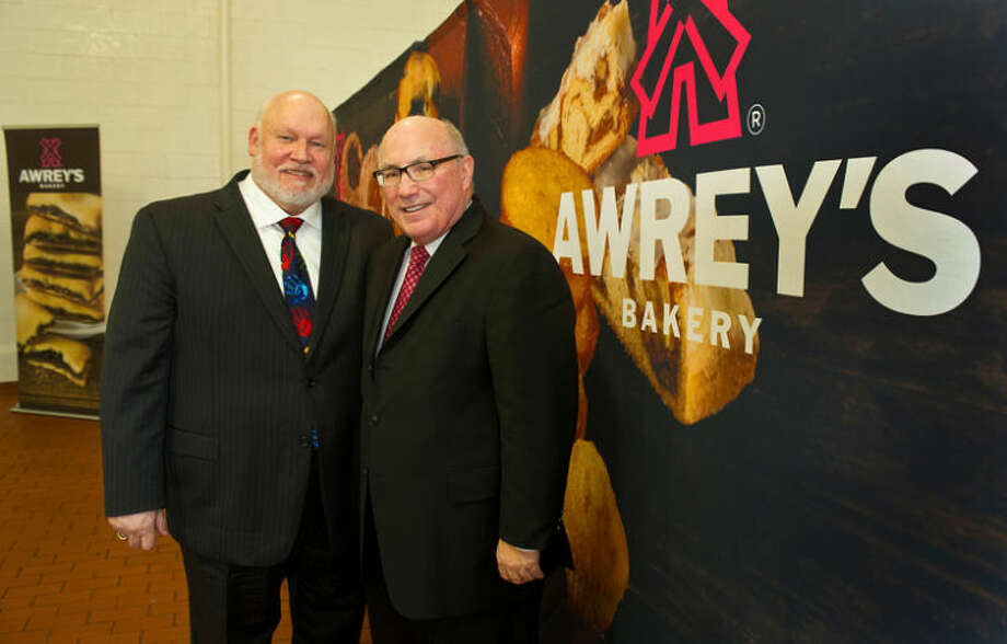 Photo provided Awrey's Bakery Chairman and Midland resident Ron Beebe (left) and CEO Jim McColgan.