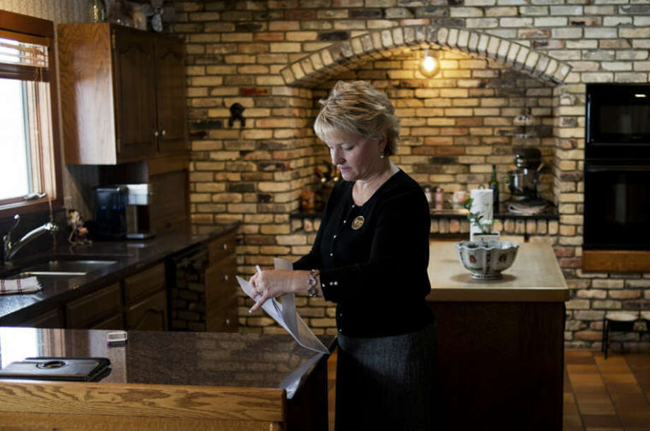 Re/Max of Midland Realtor Jodi Harbron readies a brochure before an open house at 2408 Longfellow Lane in Midland. Harbron saidMarch, April and May tend to be the busiest months in home sales but that the weather can have some effect on the market. Photo: Neil Blake/Midland  Daily News