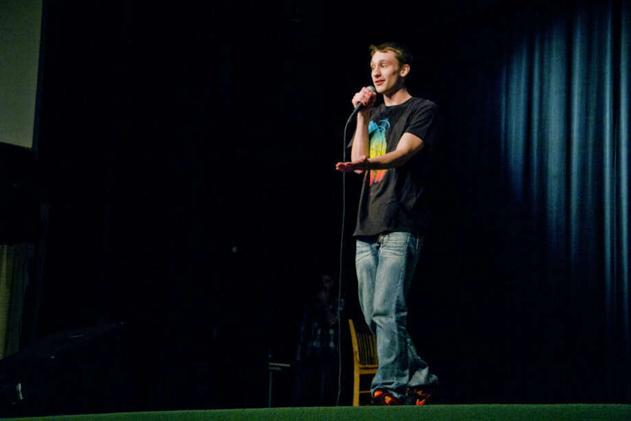 Isaiah Marr, 18, of Essexville raps on stage during the Ten16 Recovery Network's Recovery Idol at Grace A. Dow Memorial Library on Sunday afternoon. Marr rapped about his addiction and his recovery for the competition. Photo: EMILY BROUWER | For The Daily News