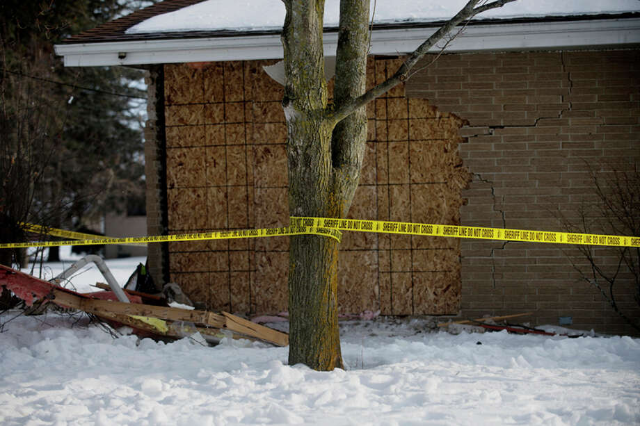 NEIL BLAKE | nblake@mdn.netPolice tape is wrapped around a tree on Sunday where a 2005 Chevrolet Tahoe crashed into a home in Auburn, killing Vaughn Lietzke, 41, who was sleeping in a bedroom in the home at 501 Ruth St. The vehicle, which police say was airborne for a time after vaulting the curb, barely missed the tree in front of the home before hitting the house. Lietzke's wife, Sandra, was also in the room at the time of the crash.