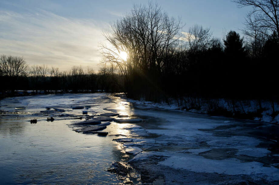 NICK KING | nking@mdn.netThe sun rises over the Pine River in Midland County. Whether the Pine and other local rivers will flood when the spring thaw hits is anyone's guess. Photo: Nick King/Midland  Daily News