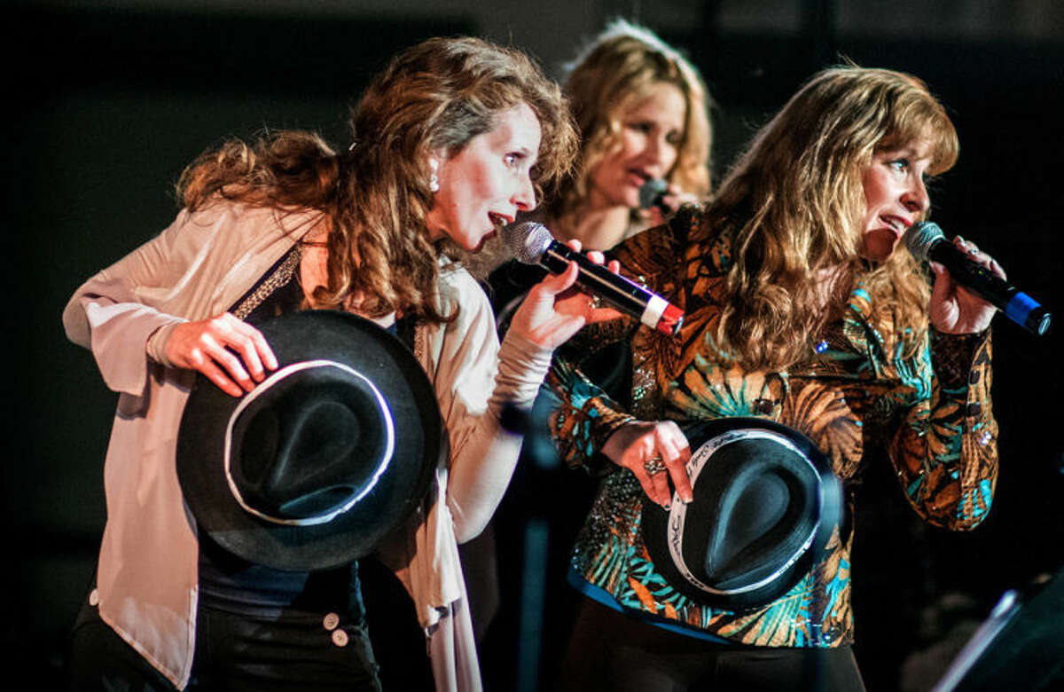 From left, Susan Johnson, Carey Owens and Judy Harrison, members of SwingShift, perform during Swingshift and the Stars Dance-off for Charity in Bay City Friday evening.