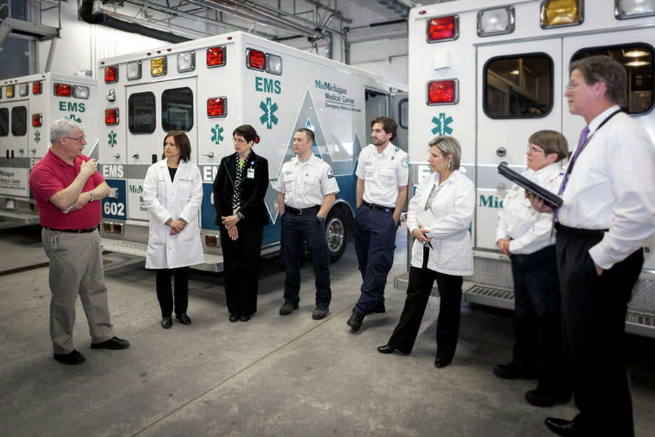 Photo providedThe safety rounds team from the Medical Center in Midland met with staff from MidMichigan Emergency Medical Services during safety rounds. Here, EMS Dispatcher Ken Debrosse speaks to the group. Also pictured from left to right are Obstetrician/Gynecologist Lydia Watson, vice president and chief quality and patient safety officer, and safety rounds team member, MidMichigan Health; Jan Penney, vice president and chief nursing officer, and safety rounds team member, MidMichigan Health; Chris Currie; Mike Wetmore; Kay Wagner, director of quality and safety rounds team member, MidMichigan Health; Denise Cole, , and Greg Rogers, president and CEO, and safety rounds team member, MidMichigan Medical Center-Midland. Safety team members not pictured are: Pam Wieske, manager of quality management, MidMichigan Medical Center-Midland, and Obstetrician/Gynecologist Margueritte Kuhn, vice president of medical affairs, MidMichigan Medical Center-Midland.