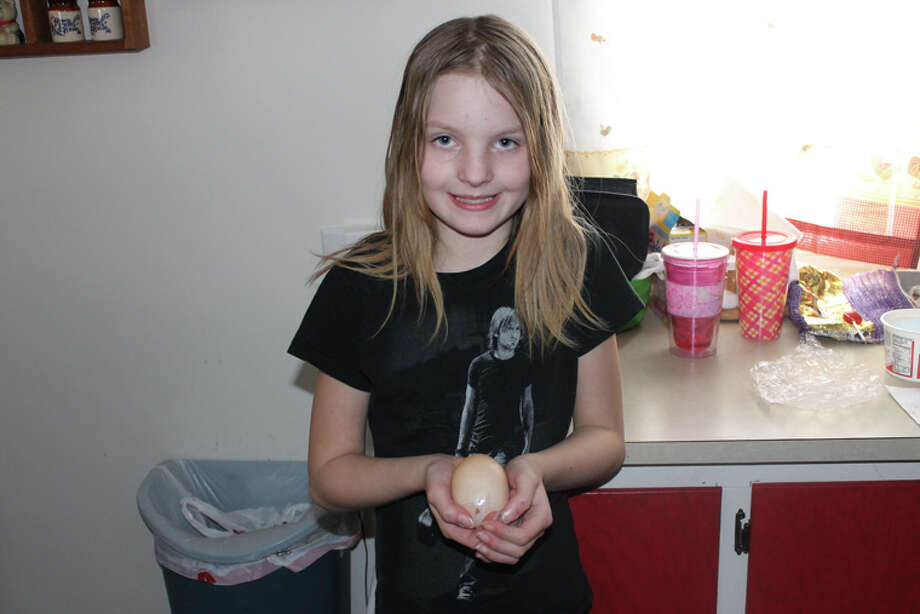 Photo providedBianca Haley, a fourth-grader at Coleman Elementary School, holds the unusually large egg.