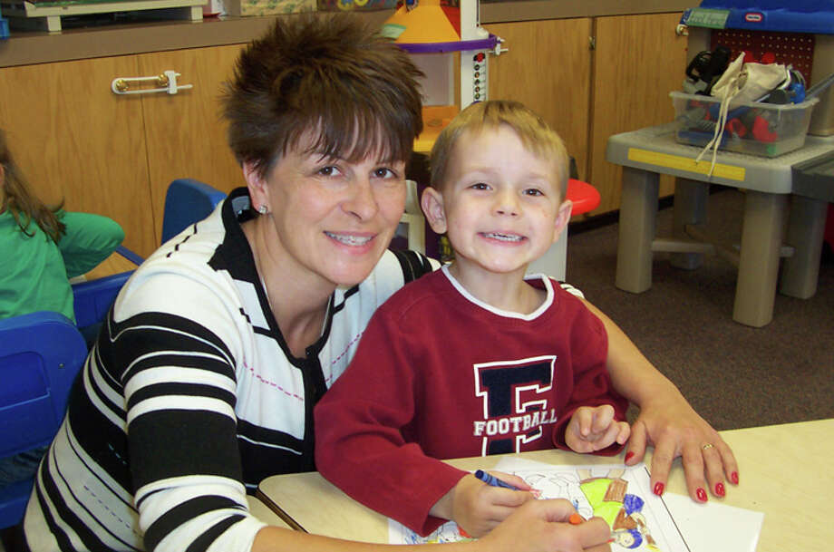 Photo providedLaura Weber, shown with a student at St. John's Lutheran School in Midland, was recently selected to receive the Distinguished Lutheran Early Childhood Administrator Award for 2014.