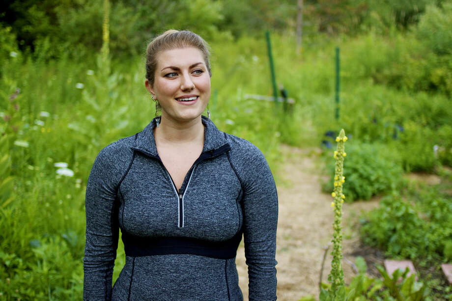 """Kristina Knopic, standing in her home garden, explains there are two parts to Earth Food: """"the permaculture, organic gardening side of things"""" and """"the baking, raw and amazing superfoods side."""" Photo: Mark Fairbrother 