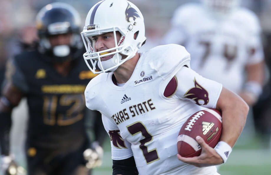 Bobcats quarterback Tyler Jones rolls in on a long touchdown run in the first half as Texas State hosts Southern Mississippi at Bobcat Stadium on Sept. 19, 2015. Photo: Tom Reel /San Antonio Express-News