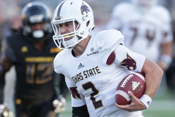 Bobcats quarterback Tyler Jones rolls in on a long touchdown run in the first half as Texas State hosts Southern Mississippi at Bobcat Stadium on Sept. 19, 2015.