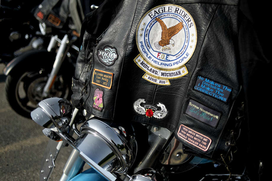 An Eagle Riders leather jacket rests on a Harley Davidson motorcycle arrive before the start of the 9th Annual LUV RIDE for Kids with Cancer Saturday at the Midland Eagles. The ride started at 11 a.m. The motorcyclists participating stopped at the Harrison, West Branch and Albright Shores Eagles before returning to Midland for a dinner, silent auction, raffle, door prizes and live music. All proceeds go to Midland Cancer Services. Photo: Nick King/Midland  Daily News