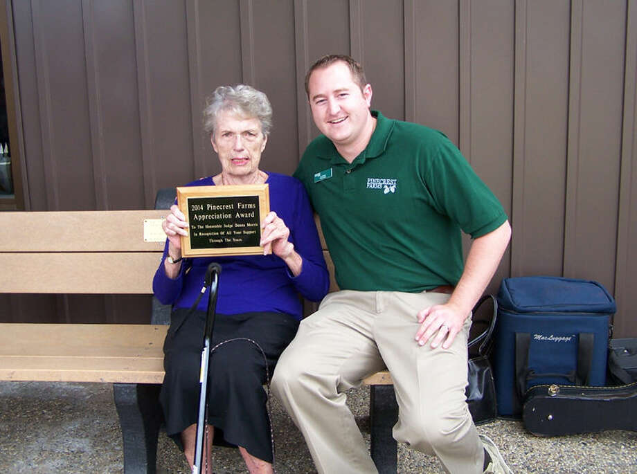 Retired Probate Judge Donna Morris, left, is shown with Pinecrest Administrator Joe Blewett at a recent pig roast where Morris was honored for her many contributions to Pinecrest Farms. Photo: Photo Provided