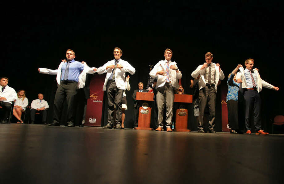 Members of the new Central Michigan University College of Medicine class put on their white coats in a traditional ceremony that took place recently on CMU's campus. Photo: Photo Provided