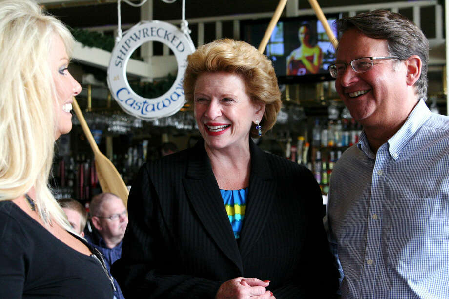 """Castaways owner Lori Dole visits with U.S. Sen. Debbie Stabenow and U.S. Rep. Gary Peters during a Bay City campaign stop as part of the duo's 'Great Lakes Jobs Tour'. Peters, a U.S. Senate candidate, stops in six other Michigan cities with Stabenow this week. """"The Great Lakes are without question the most important natural resource that we have here in Michigan,"""" Peters said. Photo: Hilary Farrell 