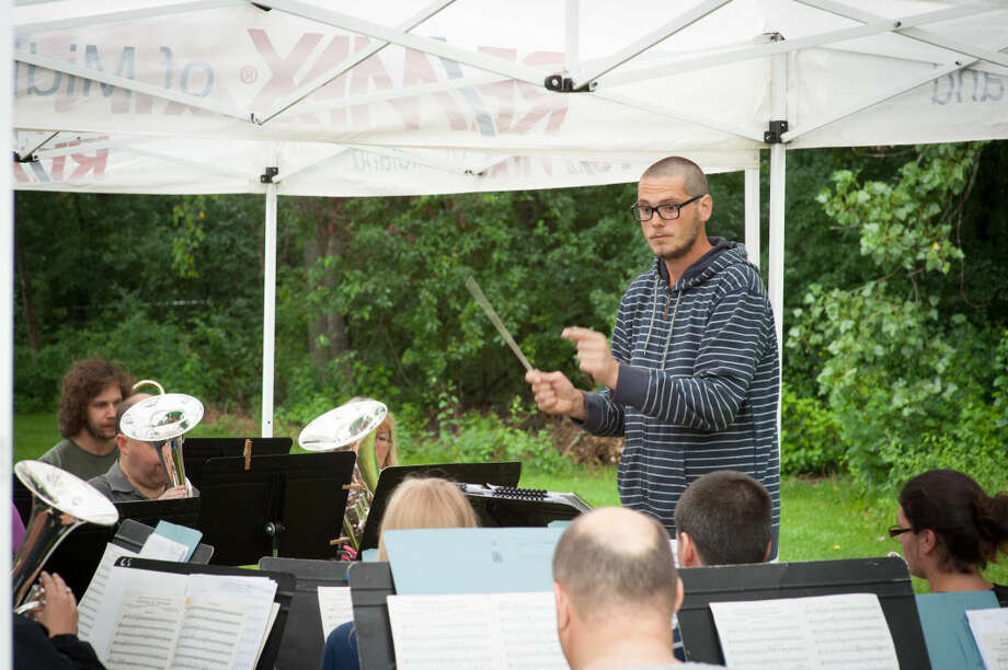 STEVEN SIMPKINS/Daily News The Pangbourne and District Silver Band meet at Jim Schutz 's house Tuesday evening to rehearse for their Wednesday Dow Gardens performance as part of their USA Tour - Michigan - 2014.