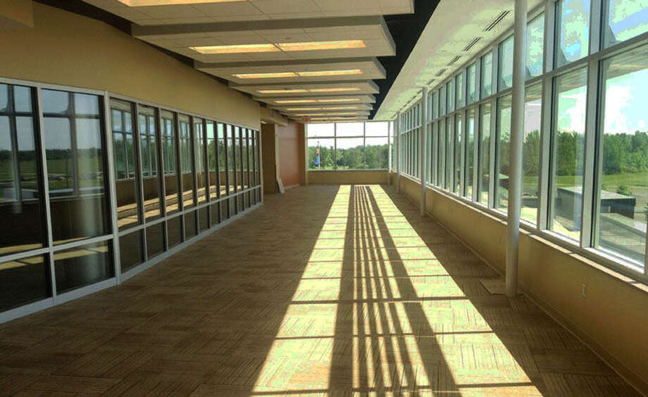 The hallway of the new Mid Michigan Community College Center for Liberal Arts and Business in Mount Pleasant is shown. The college is having an open house from 11 a.m. until 1 p.m. on Saturday, Aug. 23, so the public can see the new facility. Photo: Photo Provided