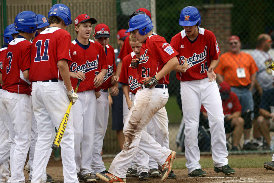 Midland's Martin Money (21) is greeted by his teammates after hitting a home run during the game against California at Heritage Park in Taylor on Tuesday. California beat Midland 9-6. Photo: NEIL BLAKE | Nblake@mdn.net