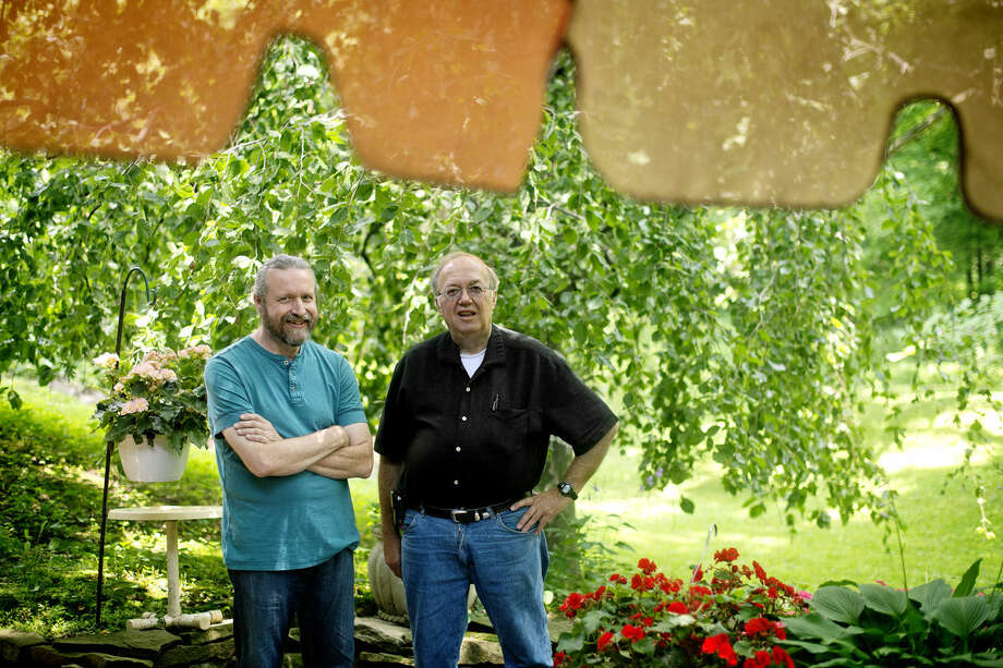 Roy Davis, right, has been holding neighborhood 'Breakfast With Roy' meet ups in his backyard for years. Neighbor Brad Arnold, left, roasts coffee beans in his garage and is responsible for bringing coffee to every breakfast whether he stays to eat or not. Photo: Nick King/Midland Daily News
