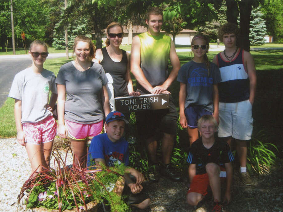 Members of the Our Legacy 4-H group recently donated their time at the Toni & Trish House. In the back row, from left, are Karsyn Sasse, Kenady Sasse, Danielle Matthews, Matt Pomaranky, Payton Gerstacker and Noah Arthur. Front row, from left, are David Draves and Hudson Gerstacker. Photo: Photo Provided