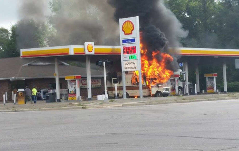 A motor home caught fire at the Shell gas station at the corner of M-20 and Meridian Road at approximately 8:30 a.m. this morning. Photo: Photo Courtesy Of Dana McCann