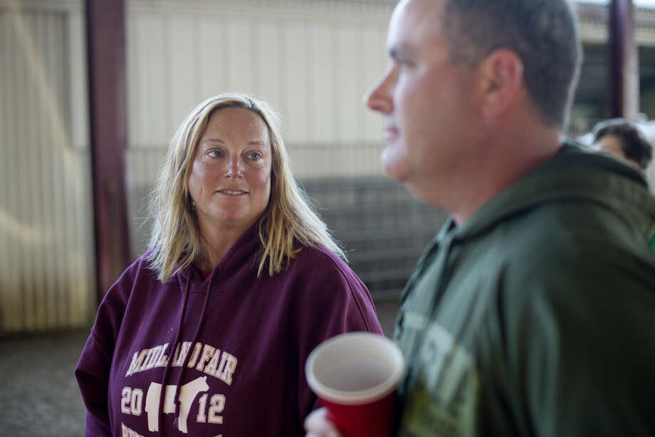 Trish Steele, the Midland County Fairgrounds manager, talks with Chad Houson of O'Keefe Electric at the Midland County Fair on Wednesday. Photo: Neil Blake/Midland Daily News