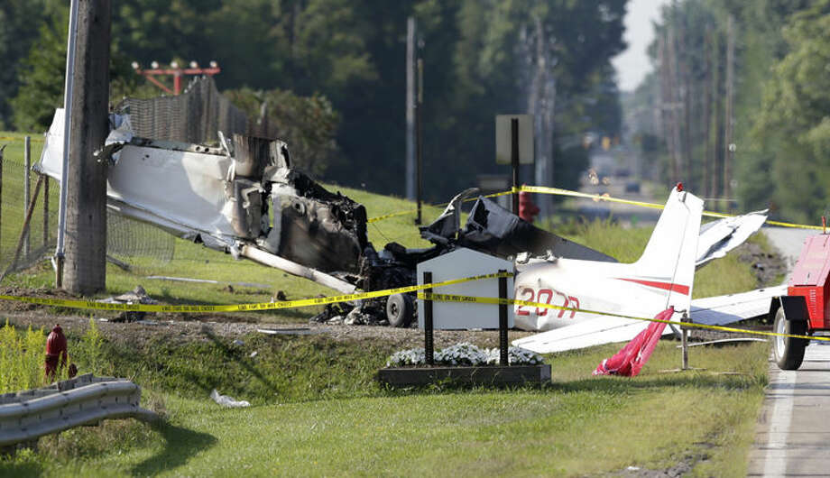The wreckage from a plane that crashed rests on the side of a road Tuesday in Richmond Heights, Ohio. Photo: AP Photo | Tony Dejak