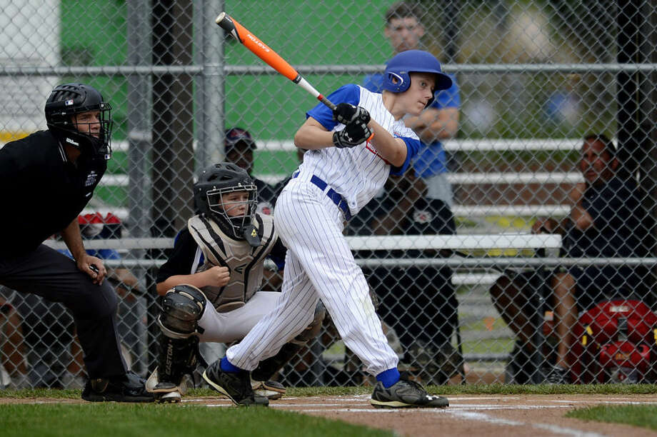 Northeast's Christopher Swanson gets a hit against Warren County South during the first inning Saturday at Ferguson Field in Indianapolis. Northeast won the Little League regional game 14-5. Photo: NICK KING | Nking@mdn.net
