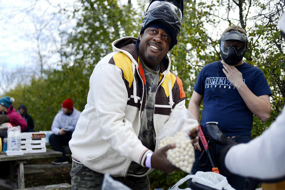 Northwood University Entertainment, Sport and Promotion Management Department Chair Preston James fills his gun with paintballs before playing a game against his students during Paintball Palooza on Sunday at the Bandit Paintball Facility in Saginaw. Photo: NICK KING | Nking@mdn.net