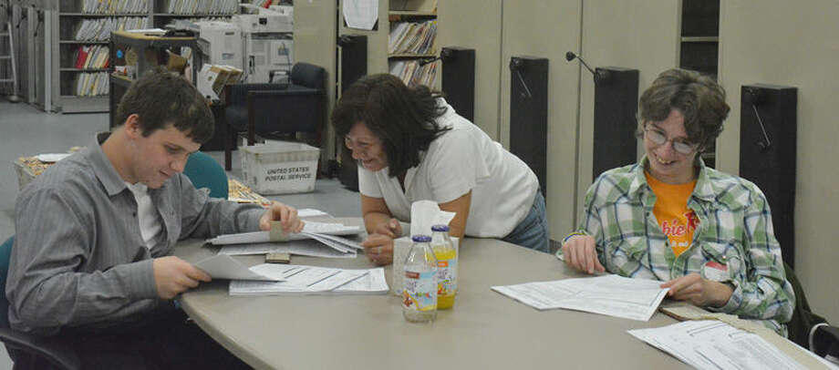 Bullock Creek students Nathan Solomon and Samuel Bailey work in the Loan Processing Department of Chemical Bank as part of Disability Mentoring Day. Photo: Photo Provided
